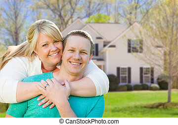 Happy Caucasian Couple in Front of New House