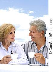 Happy Caucasian elderly couple in the street