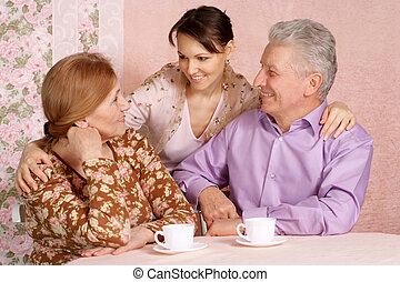Happy Caucasian elderly parents with a daughter