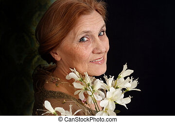 Happy Caucasian elderly woman in the background