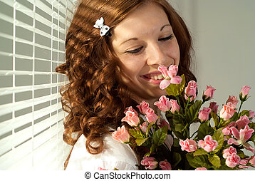 Happy Caucasian female standing with flowers