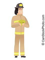 Happy caucasian firefighter holding money.