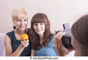 Happy Caucasian Girlfriends With Dental Bracket System Installed