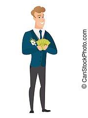 Happy caucasian groom holding money.