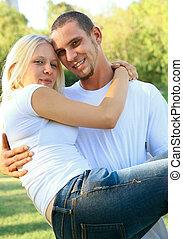 Happy Caucasian Male Holding His Girlfriend