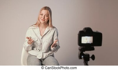 caucasian pretty student girl looking at camera making video or online teaching