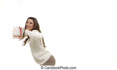 Happy caucasian woman dancing with present box in Christmas...