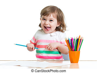 Happy cheerful child drawing with pencils