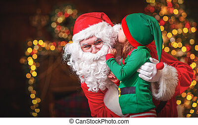 happy cheerful child elf helper and Santa Claus at Christmas