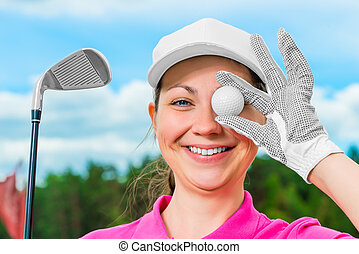 happy cheerful girl on the golf course with equipment
