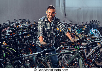 Happy cheerful is checkin bicycle - Happy smiling man in...
