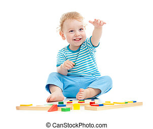 Happy cheerful kid playing educational toys isolated on...