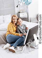 Happy cheerful woman hugging her son