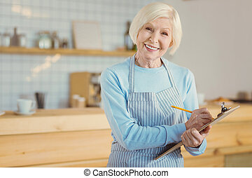 Happy cheerful woman taking notes