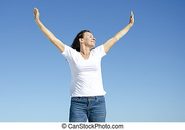 Happy cheerful woman with arms up