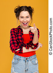 Happy cheerful young woman laughing and pointing on you