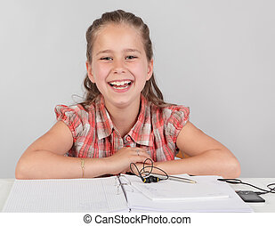Happy cheering schoolkid