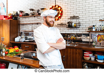 Happy chef cook standing on the kitchen - standing on the...