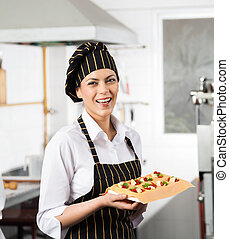 Happy Chef Holding Tray With Stuffed Pasta Sheet