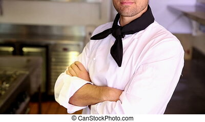 Happy chef making ok sign to camera in commercial kitchen