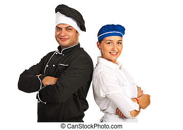 Happy chef male and waitress standing back to back with...