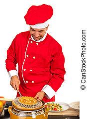 Happy chef preparing food