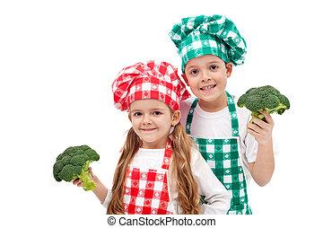 Happy chefs holding broccoli