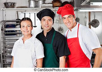 Happy Chefs In Kitchen
