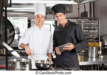 Happy Chefs With Digital Tablet Cooking Food
