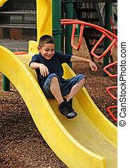 Happy child and slide