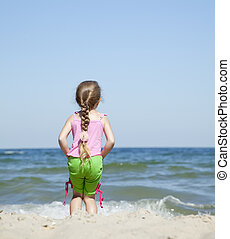 Happy child at the summer beach.