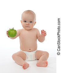child baby girl toddler sitting in diaper and eating green apple