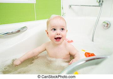 happy child boy taking bath