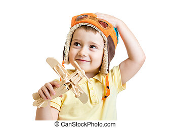 happy child boy with airplane toy dreams to be pilot