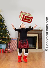 Child catching christmas present