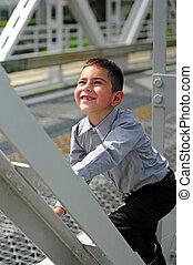Happy child climbing