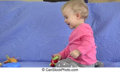Happy child, cute blonde toddler girl have fun play with...