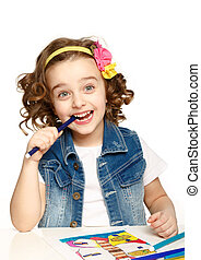 Happy child draws felt-tip pen. White background. Isolated.