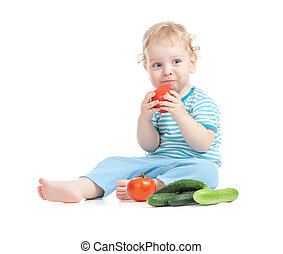 Happy child eating tomatoes. Healthy food eating concept.