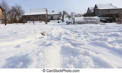 Happy child enjoy snow sled in winter morning