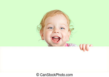 Happy child face behind blank advertising banner. Banner and green background are easily expandable in any direction.