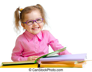 Happy child girl in glasses reading books sitting at table -...