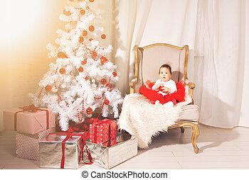 happy child girl near a Christmas tree