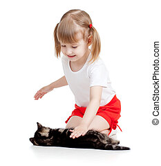 happy child girl playing with cat kitten