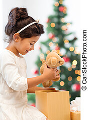 happy child girl with gift box and teddy bear - holidays,...