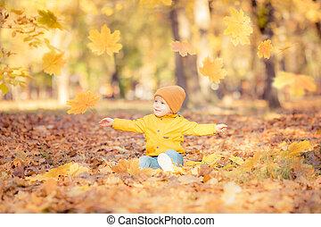 Happy child having fun in autumn park