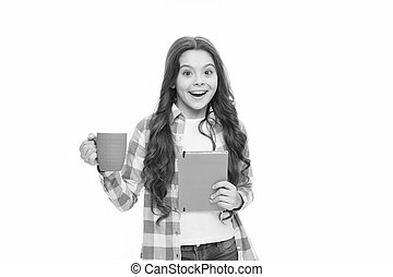 happy child hold note book and tea cup. ready for reading. little business lady. back to school. surprised school gorl drink tea. time for rest. Spend nice time with favorite book. reading book lover
