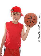Happy child holding basketball