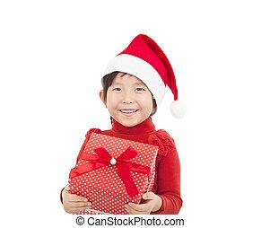 happy child holding christmas gift