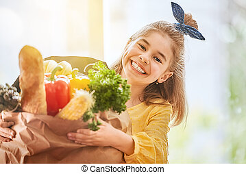 child holding grocery shopping bag